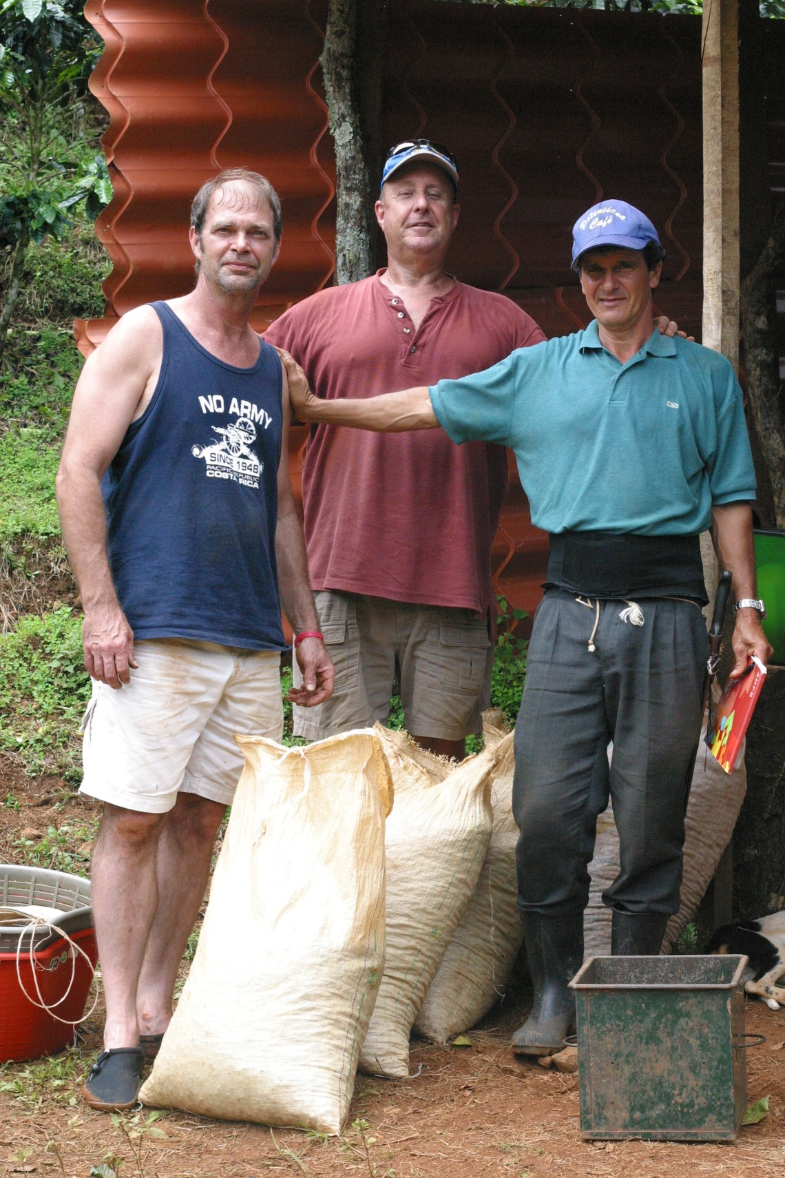 Mike, Bill, and their farm manager Gerardo