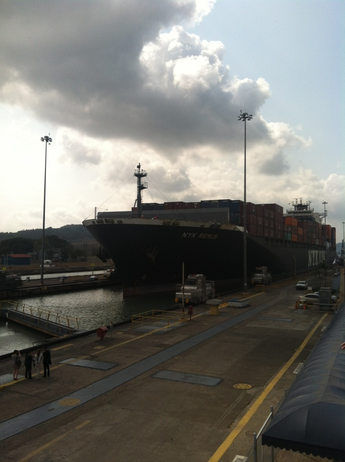 Container ship passing through the Miraflores Locks of the Panama Canal on its way to the Pacific