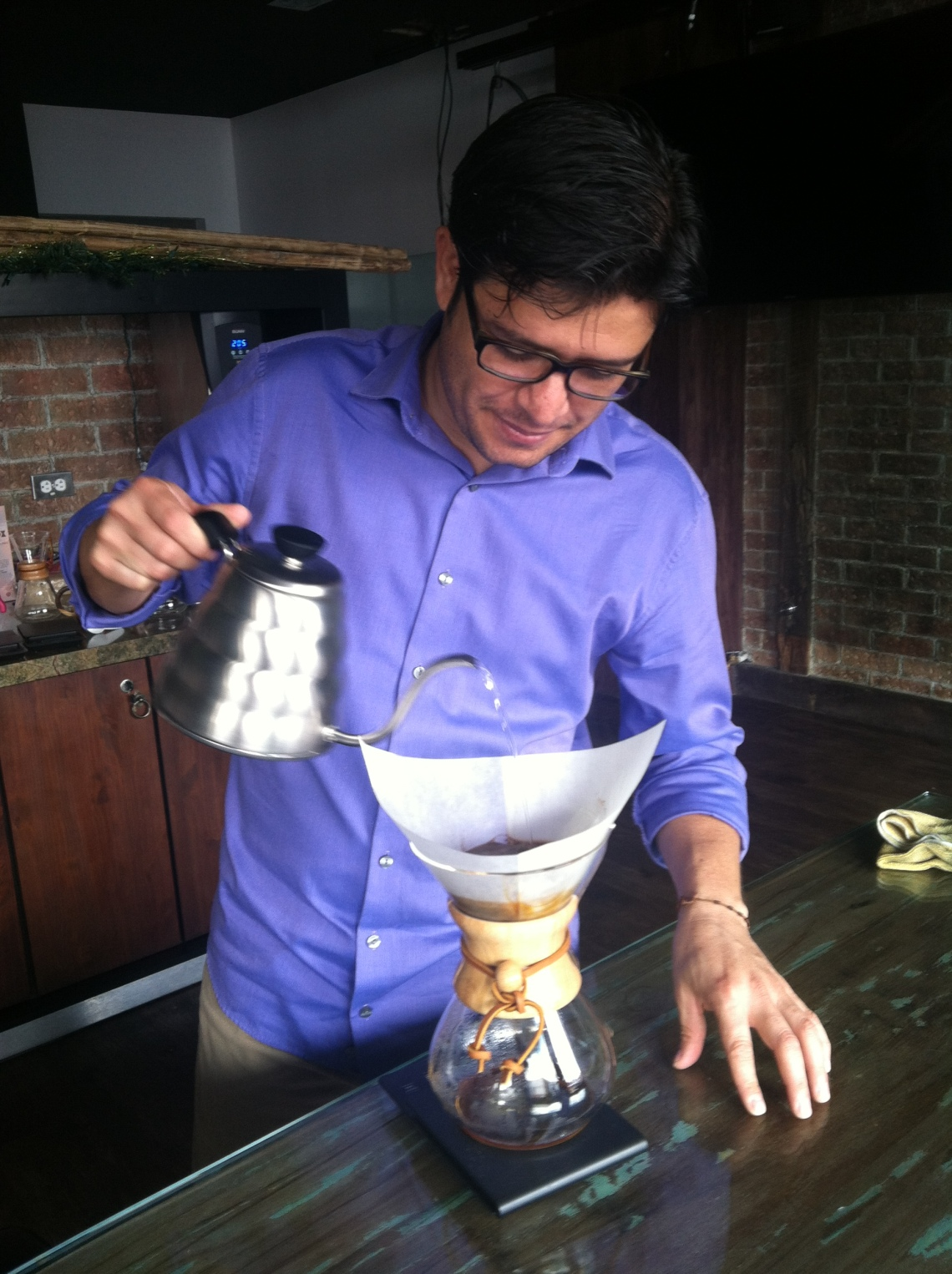Ricardo preparing a Chemex by hand at the new Costa Rican Academy in San Jose