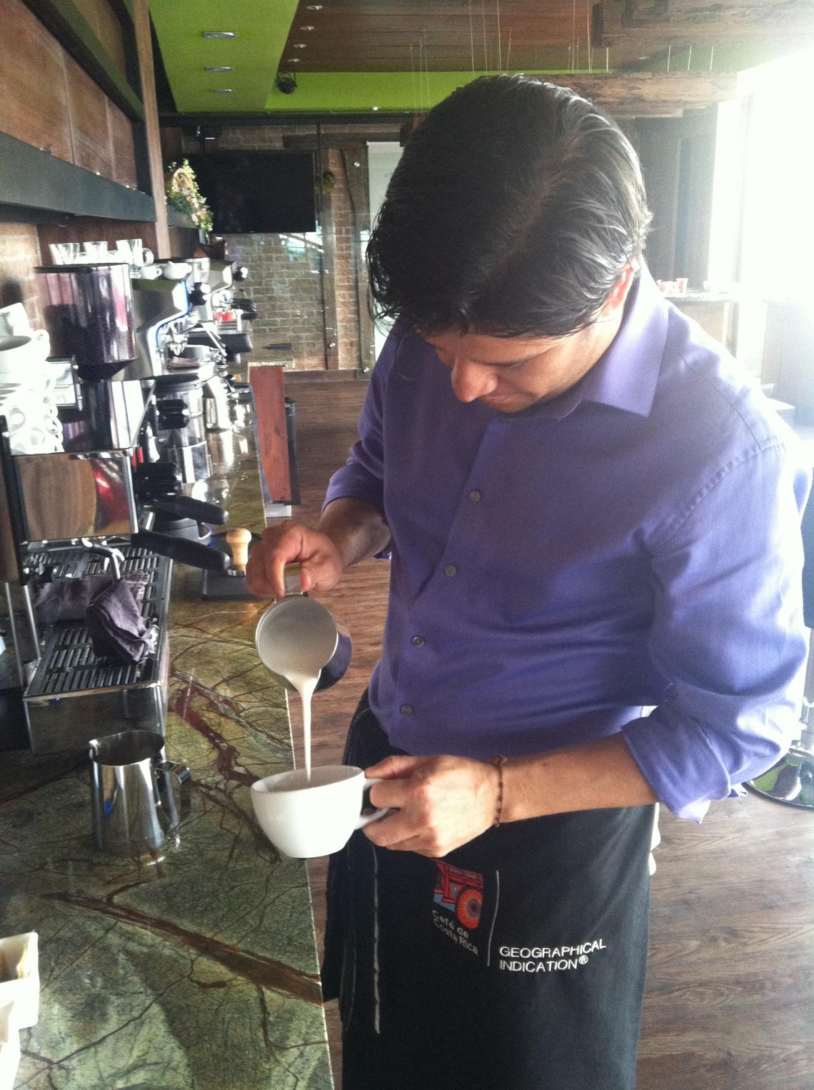 And performing the delicate hand pour required for latte art
