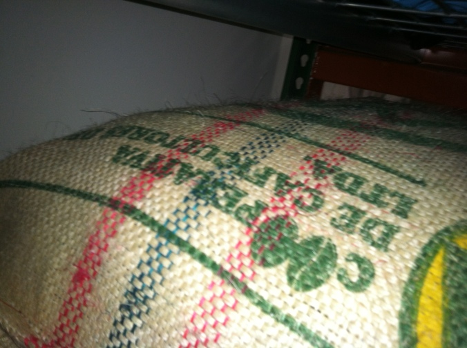 Coffee from Cooperandes, the co-op Luis and his family sell to, in the green coffee storage of Toby's Estate Brookly, bringing home the recognition.