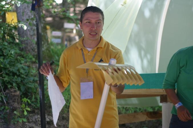 Teacher explaining how PVC rakes won't rot like wooden ones, and explaining how to make them